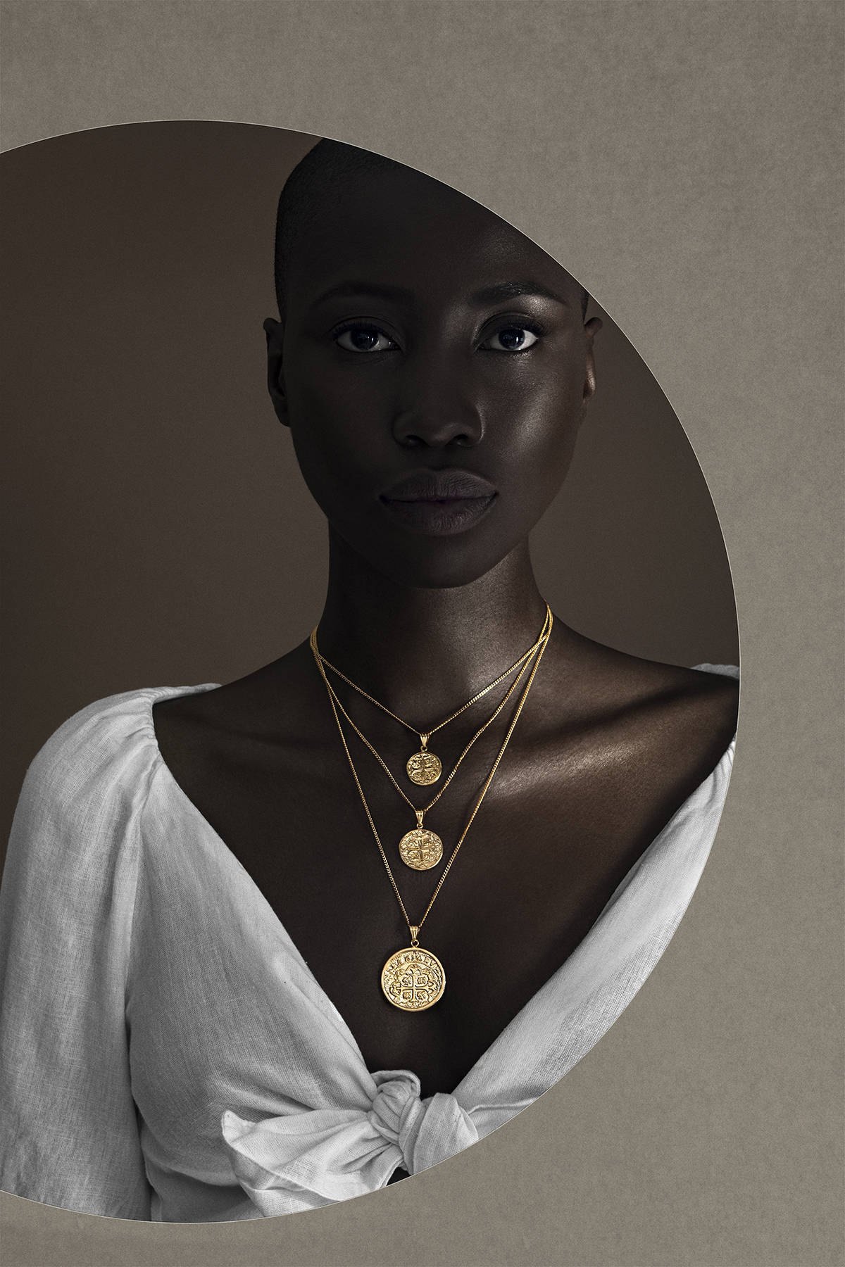 nashira arno jewerly nyc latin american designer from dominican republic modern sculptural statement gold jewelry coin necklace pendant layer.jpg