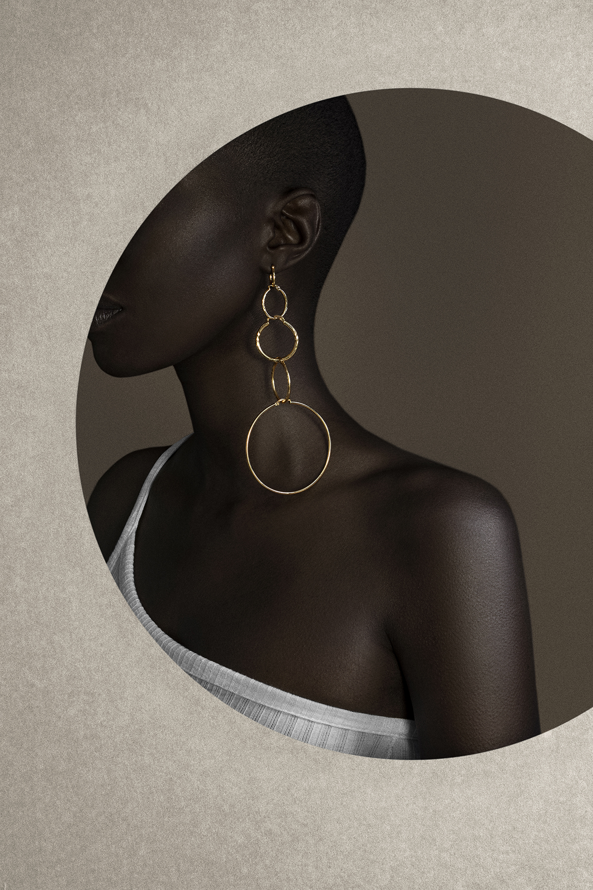 Giannina oteto for nashira arno jewerly nyc latin american designer from dominican republic modern sculptural statement gold jewelry earrings hoops art director raylin diaz.jpg