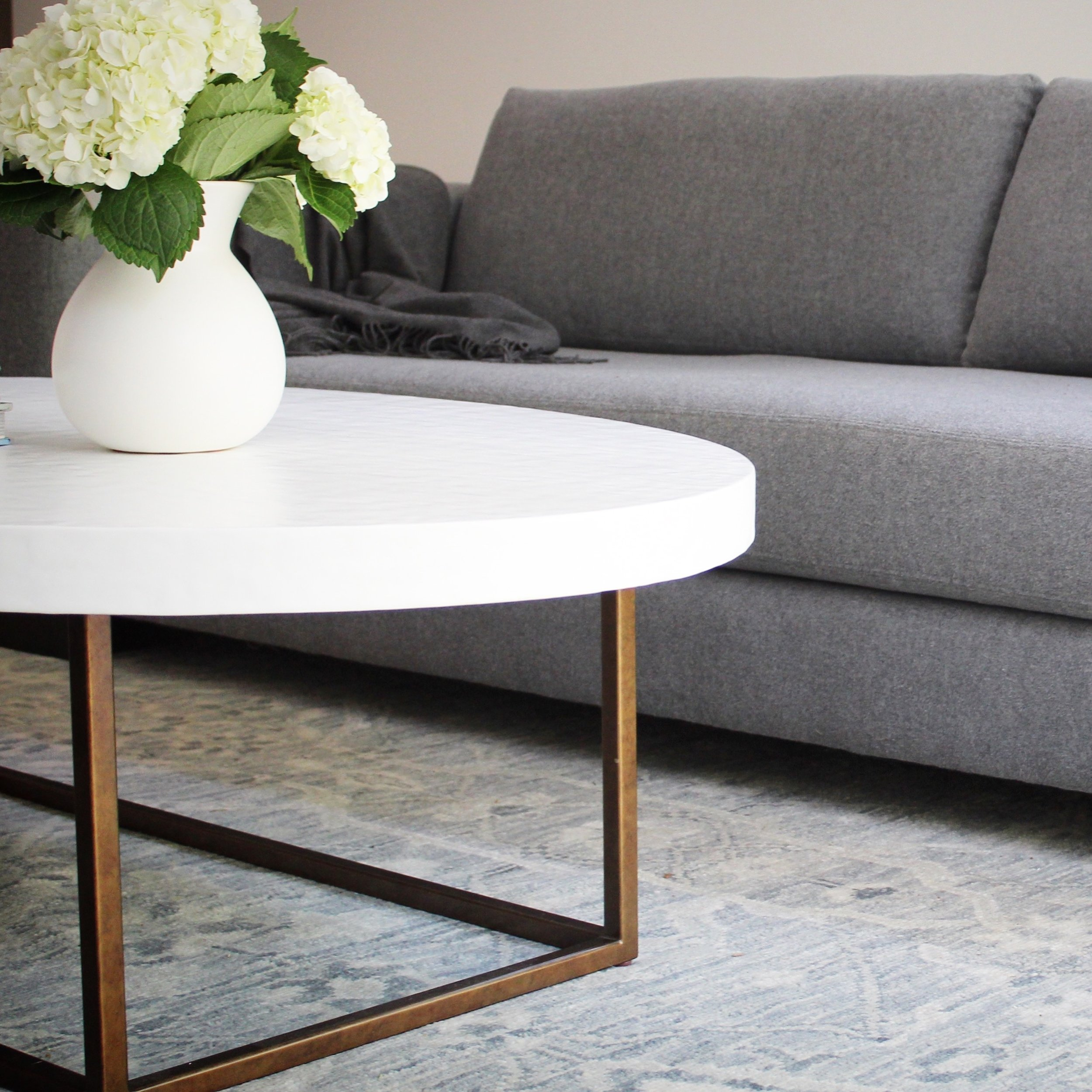 The coffee table centered between the sofas is an elegant and easy piece from Bungalow Classic.