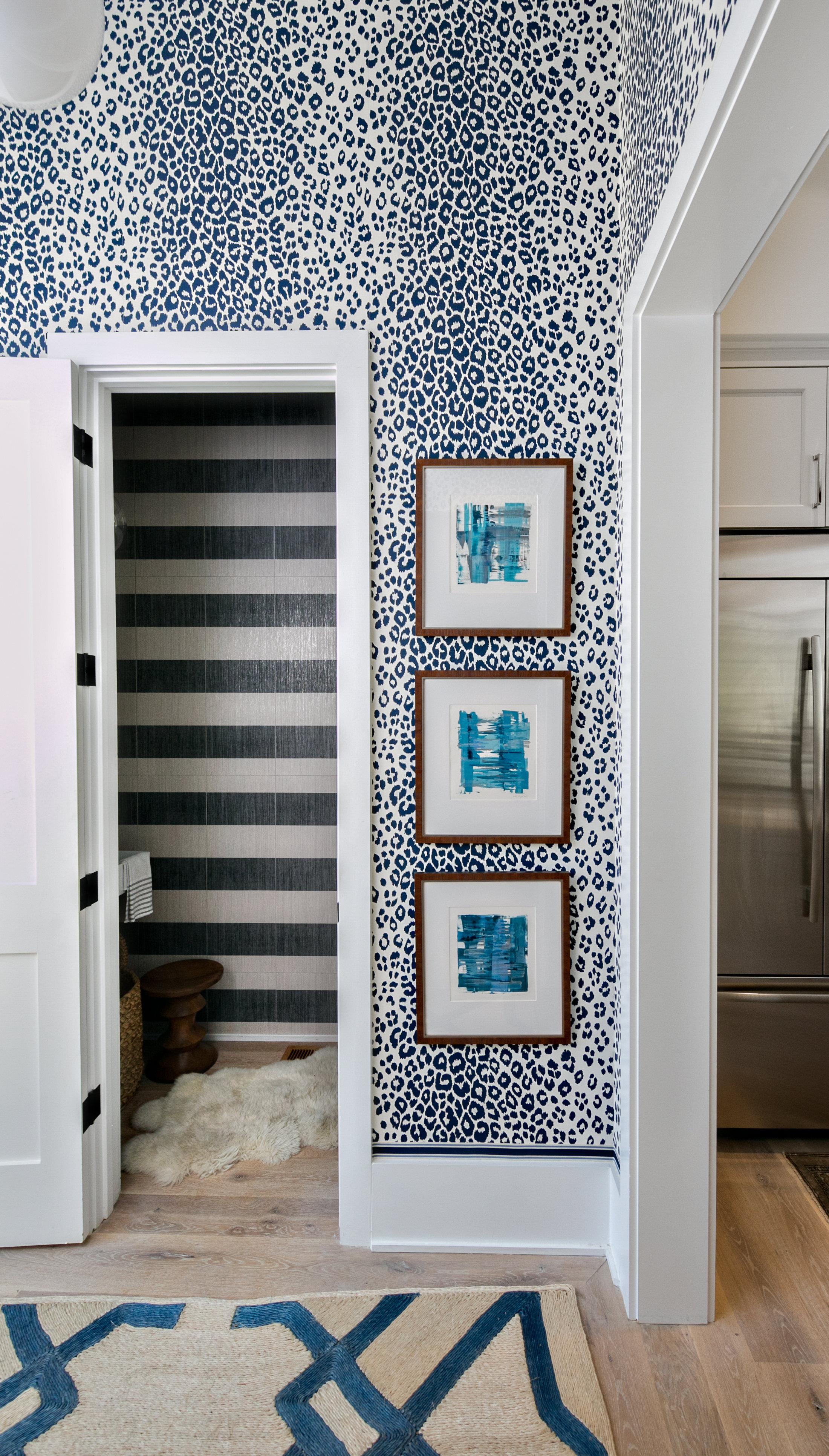 The wallpaper is Schumacher Iconic Leopard and the art is by San Francisco artist Chloe Meyer.