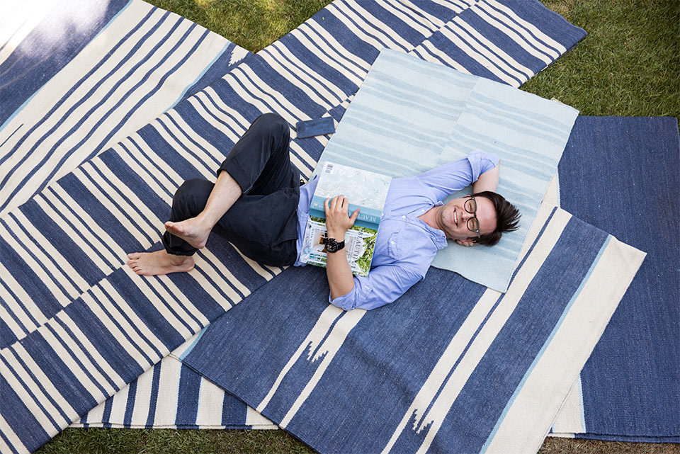 Mark, his book and some of the rugs from his partnership with Merida Studio.   Photo - Amy Neunsinger via toryburch.com