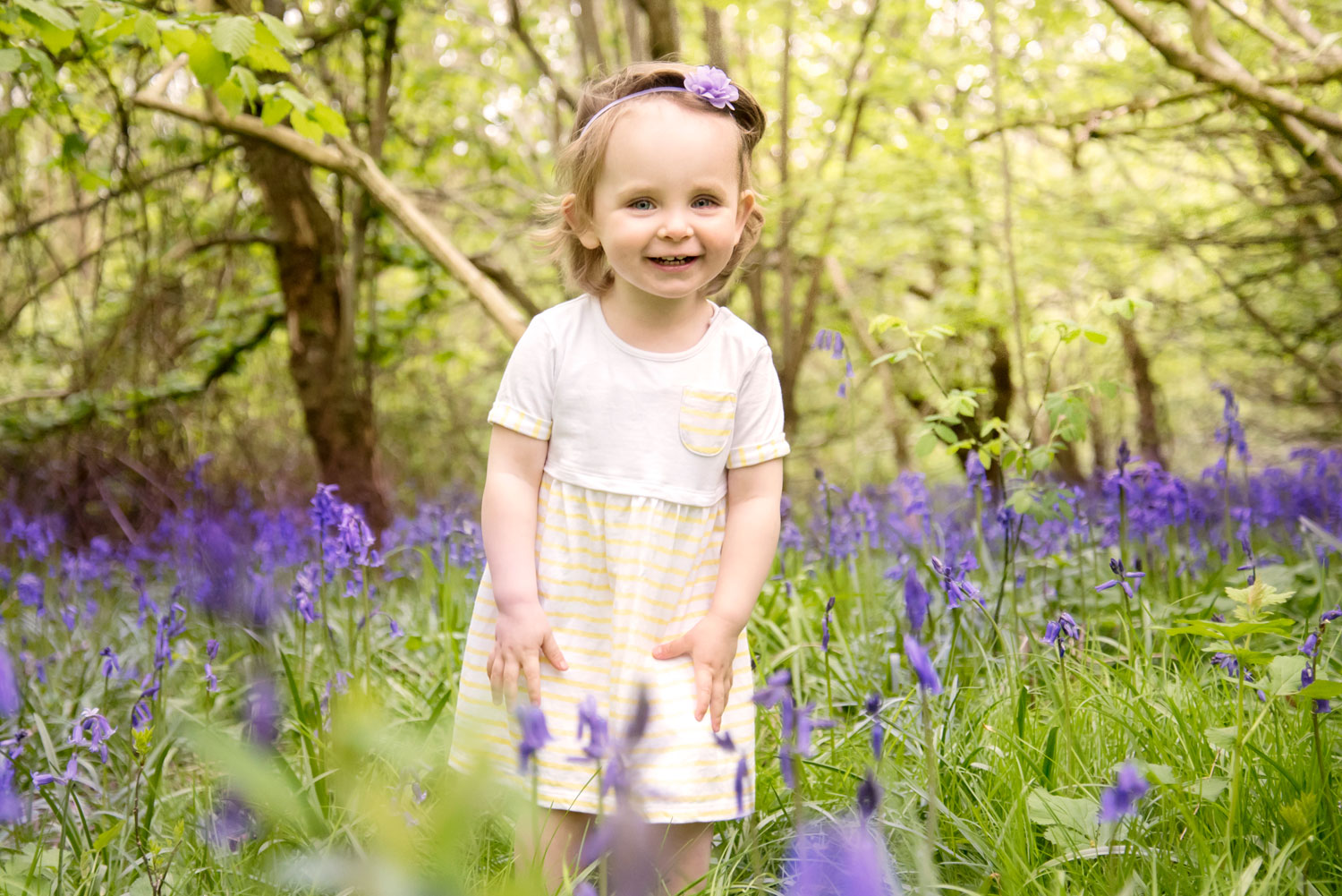 Baby_photography_Ely_Cambridgeshire-poppy-in-bluebell-woods.jpg