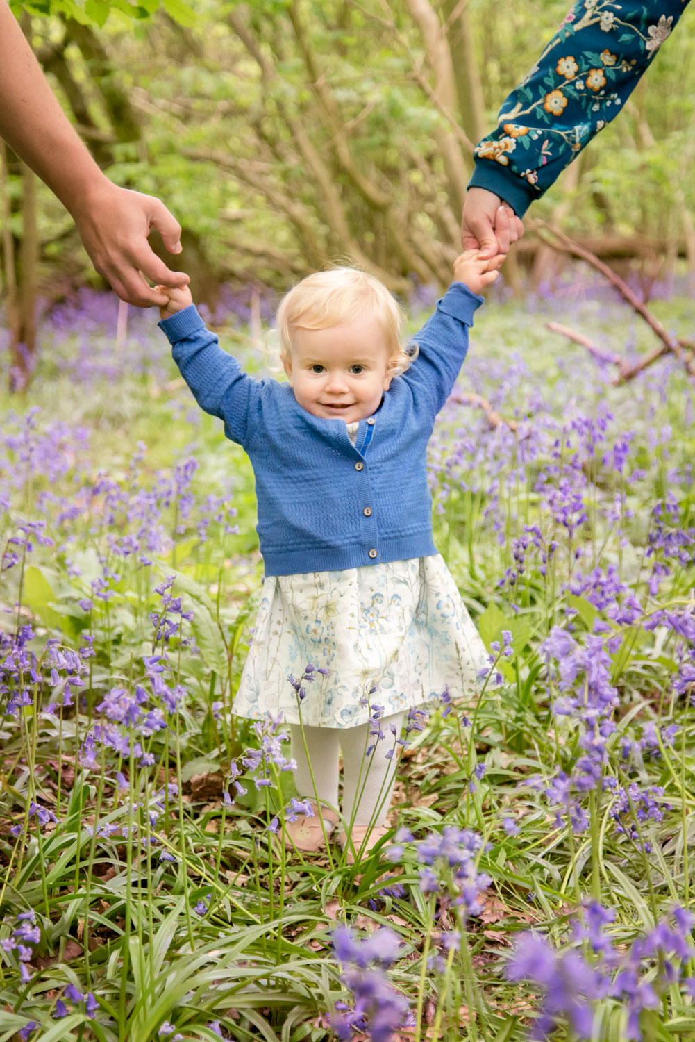 Baby_photography_Ely_Cambridgeshire-learning-to-walk-in-bluebell-wood.jpg