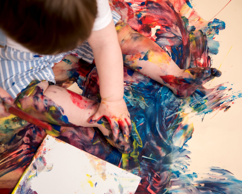 Baby_cake_smash_photography_Ely_Cambridgeshire_paint_splash_cake_smash_alternative_messy_play_first_birthday_for_milo (5).jpg