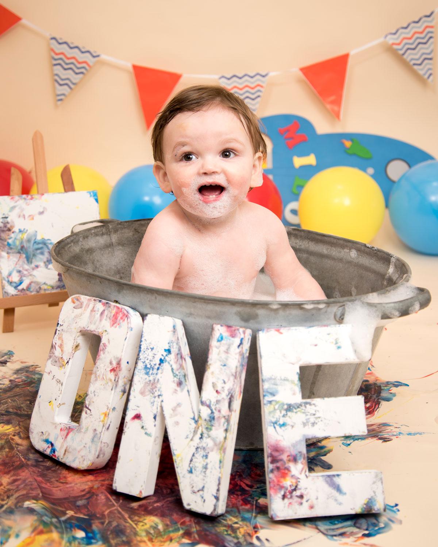 Baby_cake_smash_photography_Ely_Cambridgeshire_paint_splash_cake_smash_alternative_messy_play_first_birthday_for_milo (1).jpg