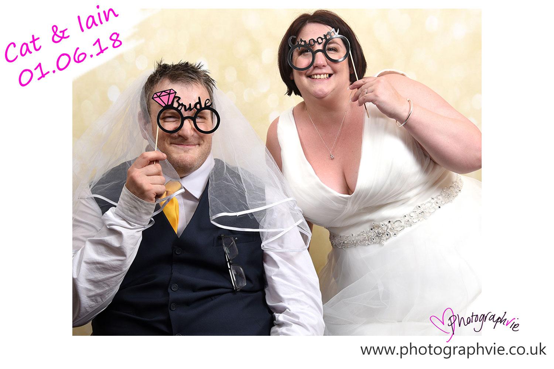 Wedding_photography_Ely_Cambridgeshire_east_anglia_marriot_hotel_huntingdon_bride_and_groom_in_photobooth.jpg