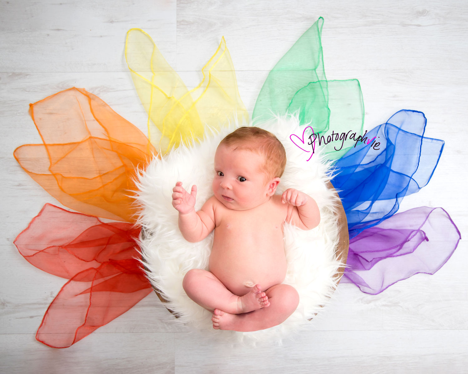 Newborn_Baby_photography_Ely_Cambridgeshire-Antiphospholipid syndrome-rainbow_baby-photo-of-new-baby-surrounded-by-a-rainbow-of-colours.jpg