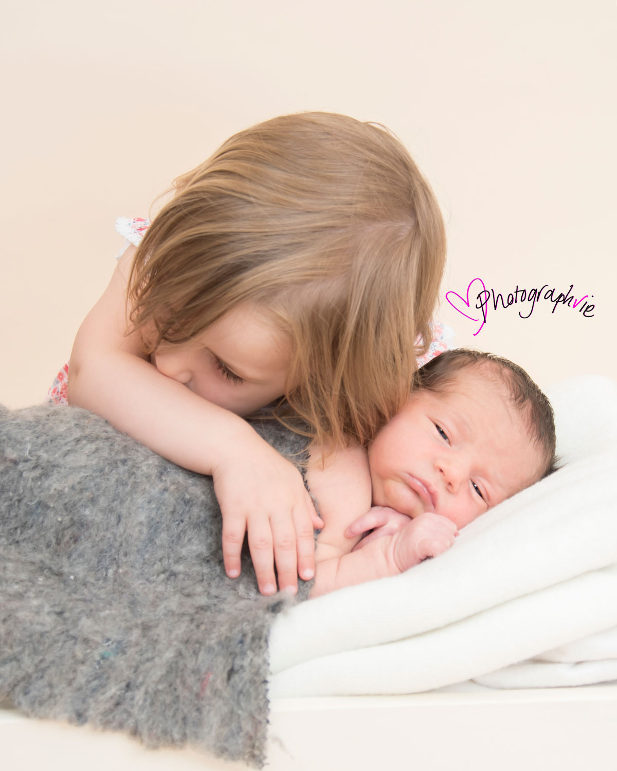 Newborn_Baby_photography_Ely_Cambridgeshire-baby-finley-cuddles-with-big-sister.jpg