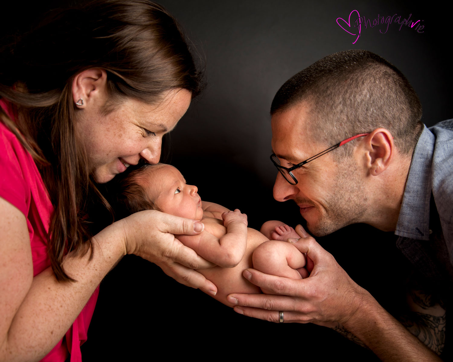 Newborn_Baby_photography_Ely_Cambridgeshire-baby-finley-black-backdrop-close-up-of-parents-and-baby.jpg
