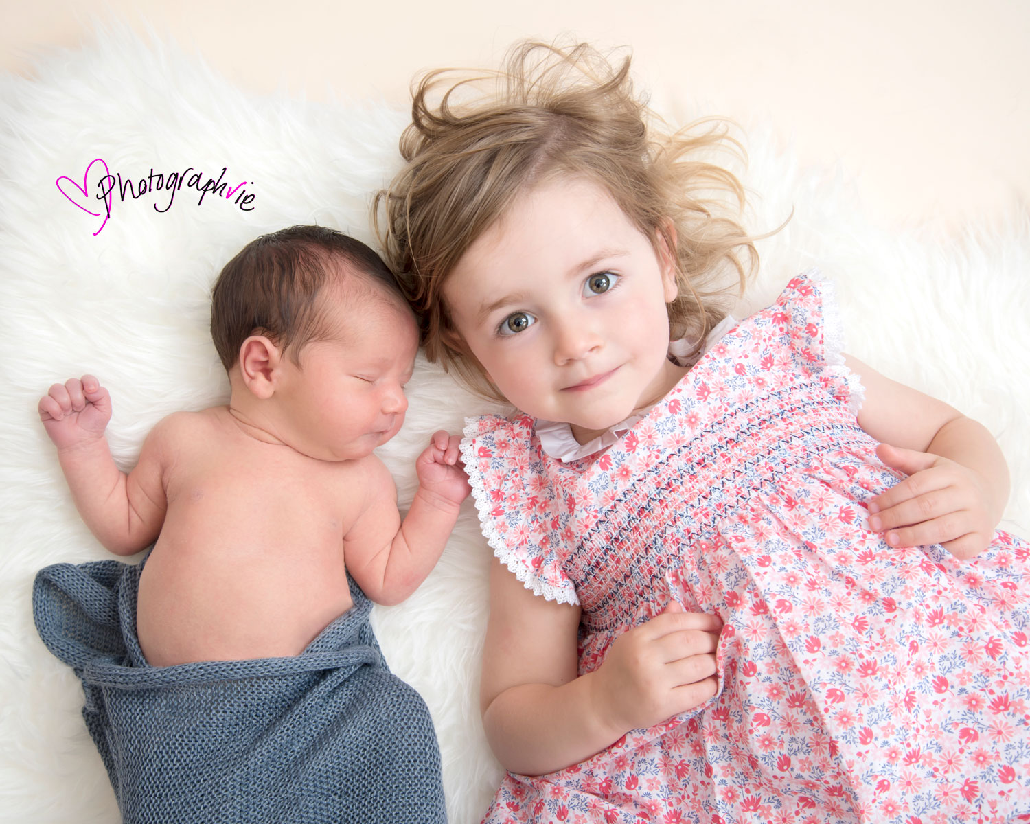 Newborn_Baby_photography_Ely_Cambridgeshire-baby-finley-lying-on-back-with-sister.jpg