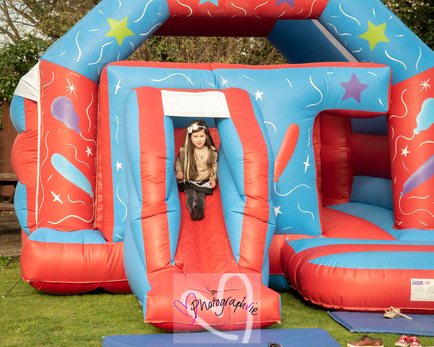 bouncy castle hire at soham wedding children playing outside photos by photographvie wedding photographer specialist