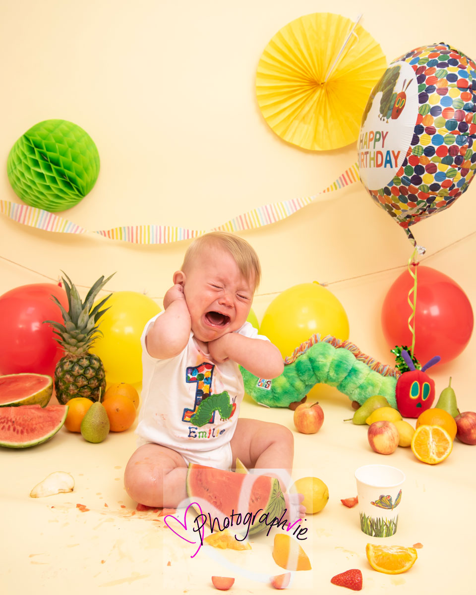 Emilie playing the 'I'm not eating that' game at her first birthday fruit smash photoshoot (disclaimer she had eaten quite a bit by this stage!!)