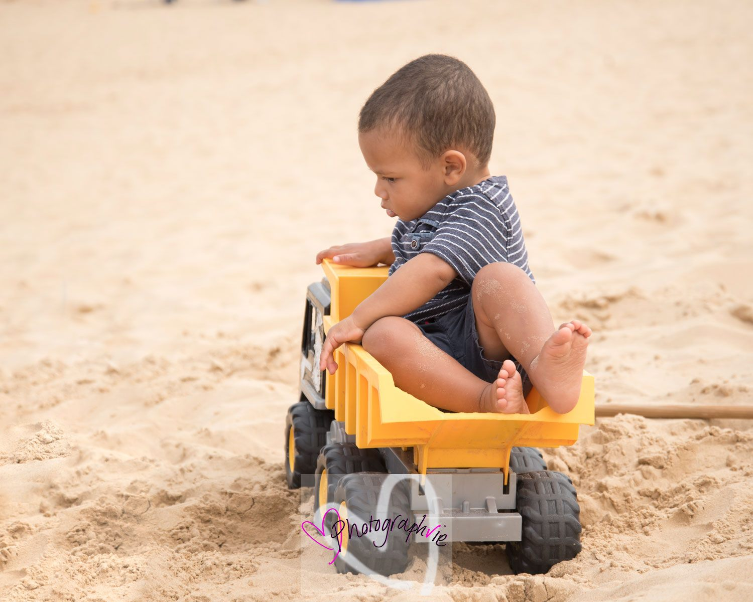 baby in digger at the beach, family photoshoot in wells by ely photographer.jpg