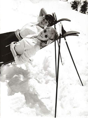 """Late 1950s, at an unidentified resort on the White River National Forest, two women pose for a €œâ€glamourous"""" ski photo while taking a break between runs."""