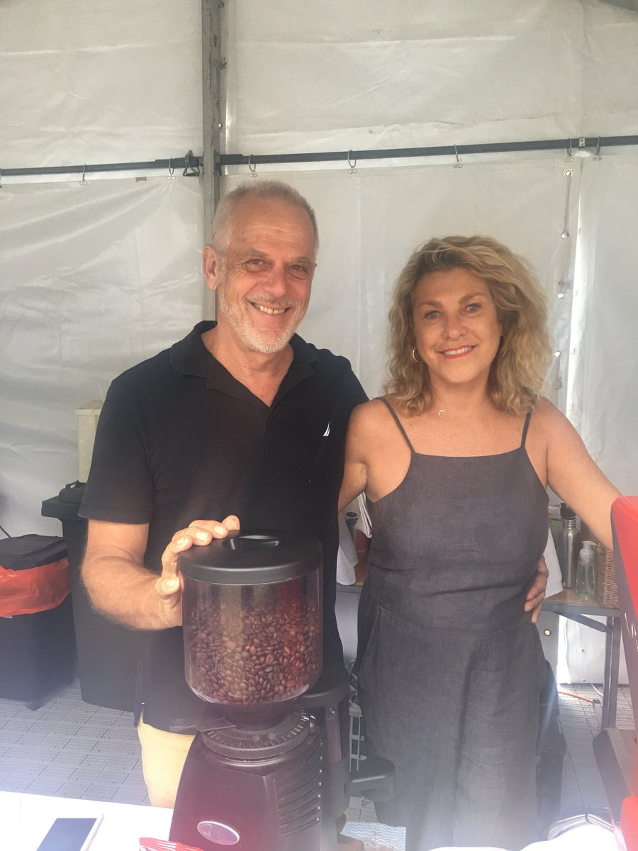 Greg and Barbara   They are enjoying meeting everyone, the enthusiastic vibes, and gather coffee beans to compost as they refresh the crowds at Currumbin Beach Front.