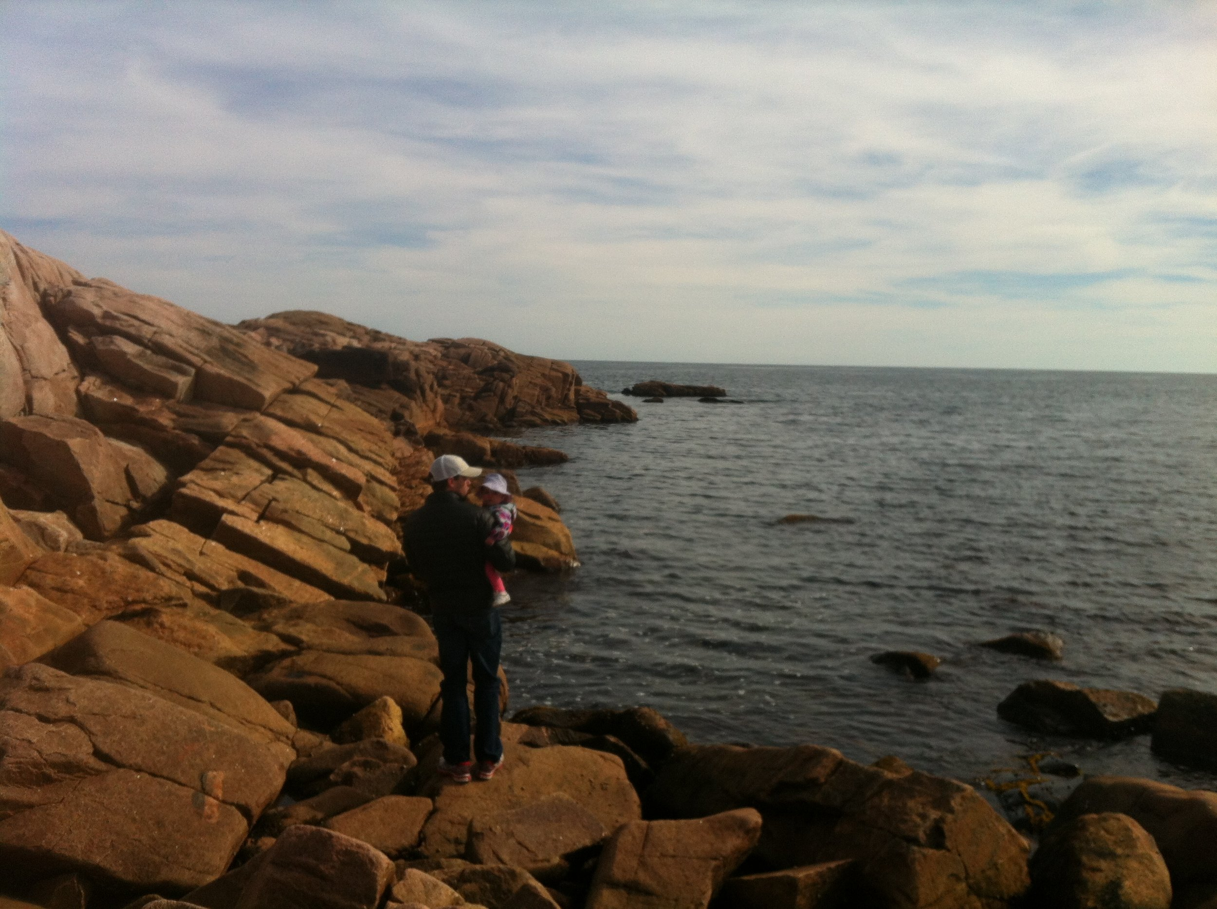 Just a dad and his gal, fearless on the cliffs of Novia Scotia.