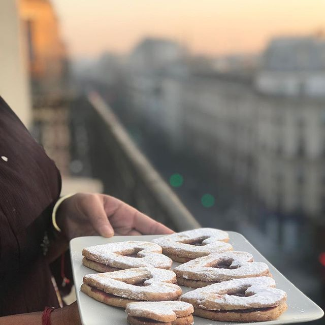 "What is better than homemade ""Sablé"" heart shaped cookies and a Parisian sunset? Absolutely nothing. . . . . . #dessertsofparis #sablé #shortbread #frenchcookies #Santé #sunsetsofparis #wineanddessertpairing #wine #desserts #champagne #paristours #winetasting #bonneboucheevent #champagneflowing #bonnebouche #bonneboucheevent #comeeatwithus #foodandwinetours #foodandwinetravel #thebonnebouche #wineetbeauté #wineaficionado #instafrance #instaparis #instatravel #instagood #instadessert #instawine"