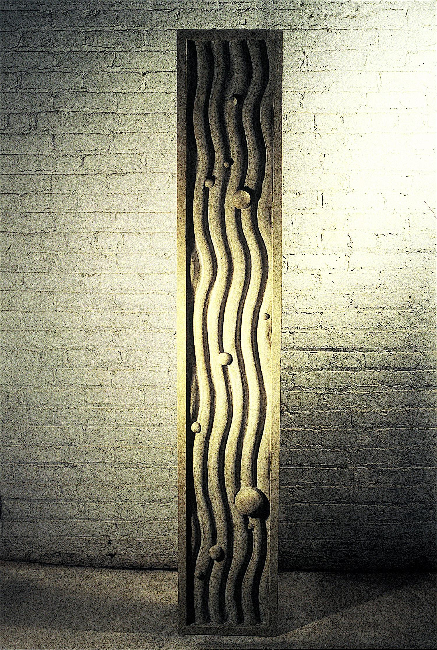 """Thomas Coffin - Particles in Waves, 72""""h x 12""""w x 5 1/2""""d, cast concrete"""