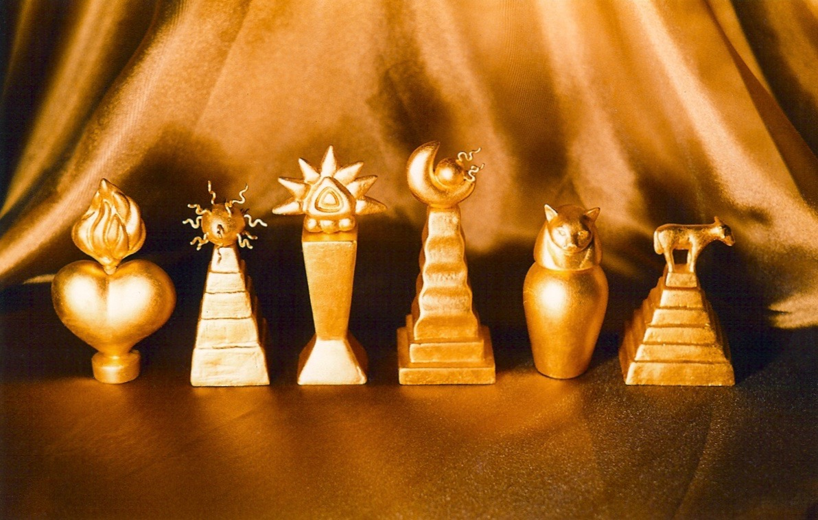 Coffin & King - Gilded Perfume Bottles - Heart, Sun God, Golden Idol, Half Moon, Cat, Golden Calf, cast stone, glass lined, 23 kt. gold leaf, 1990s