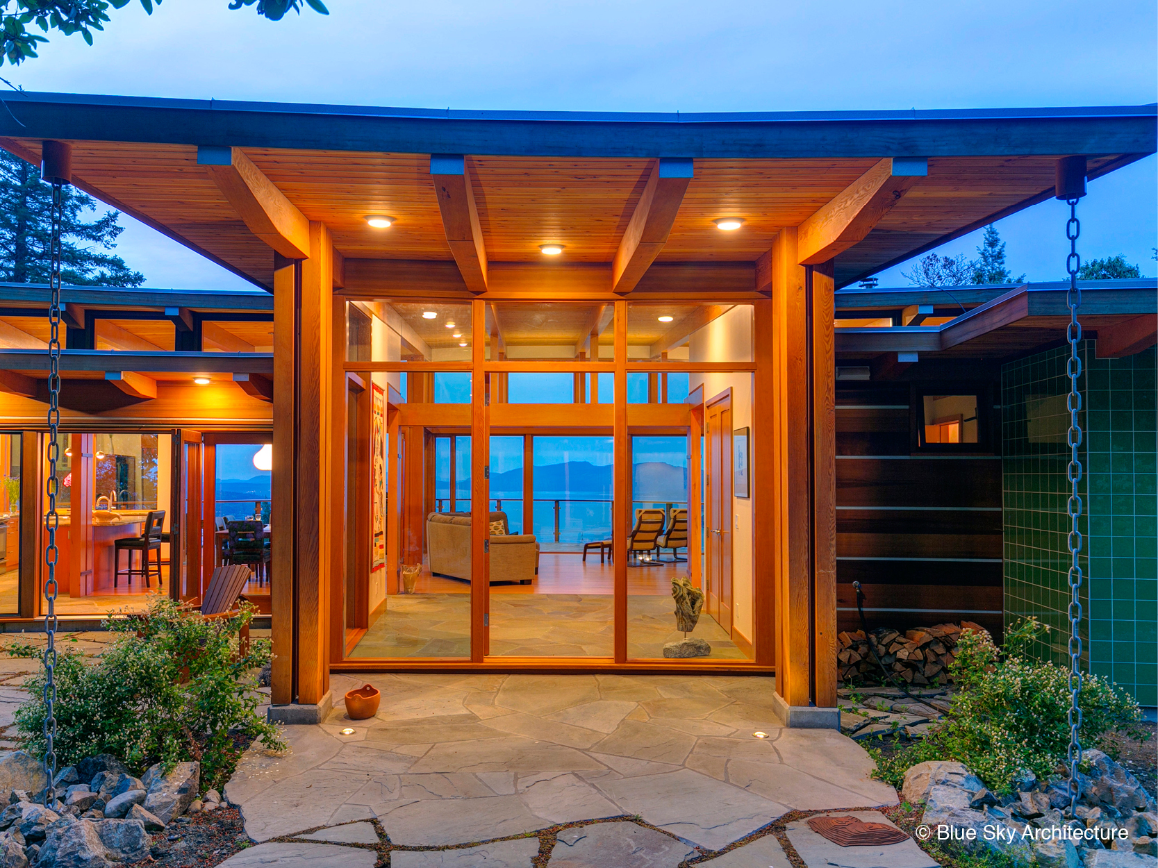 Island residential architecture with heavy timber entryway