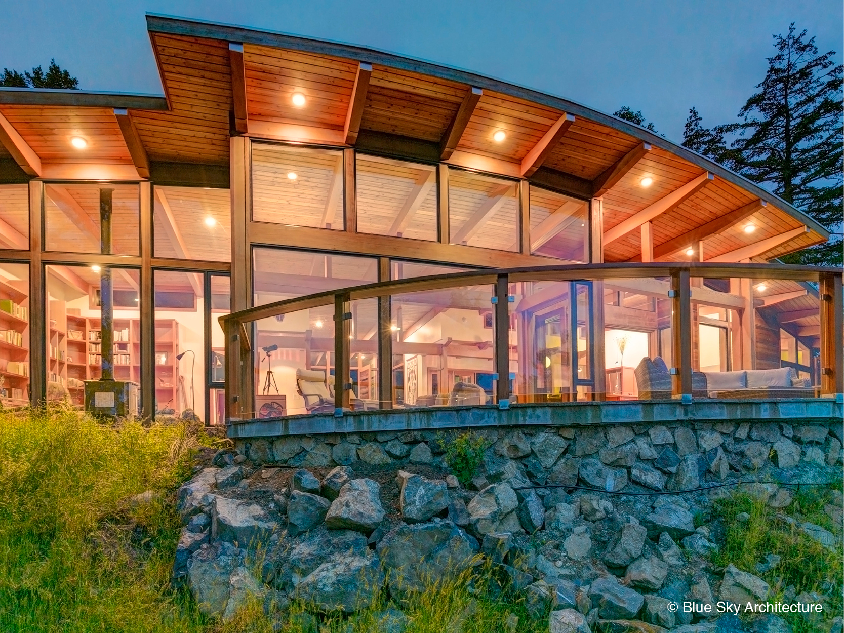 Exterior heavy timber framing on island residential design