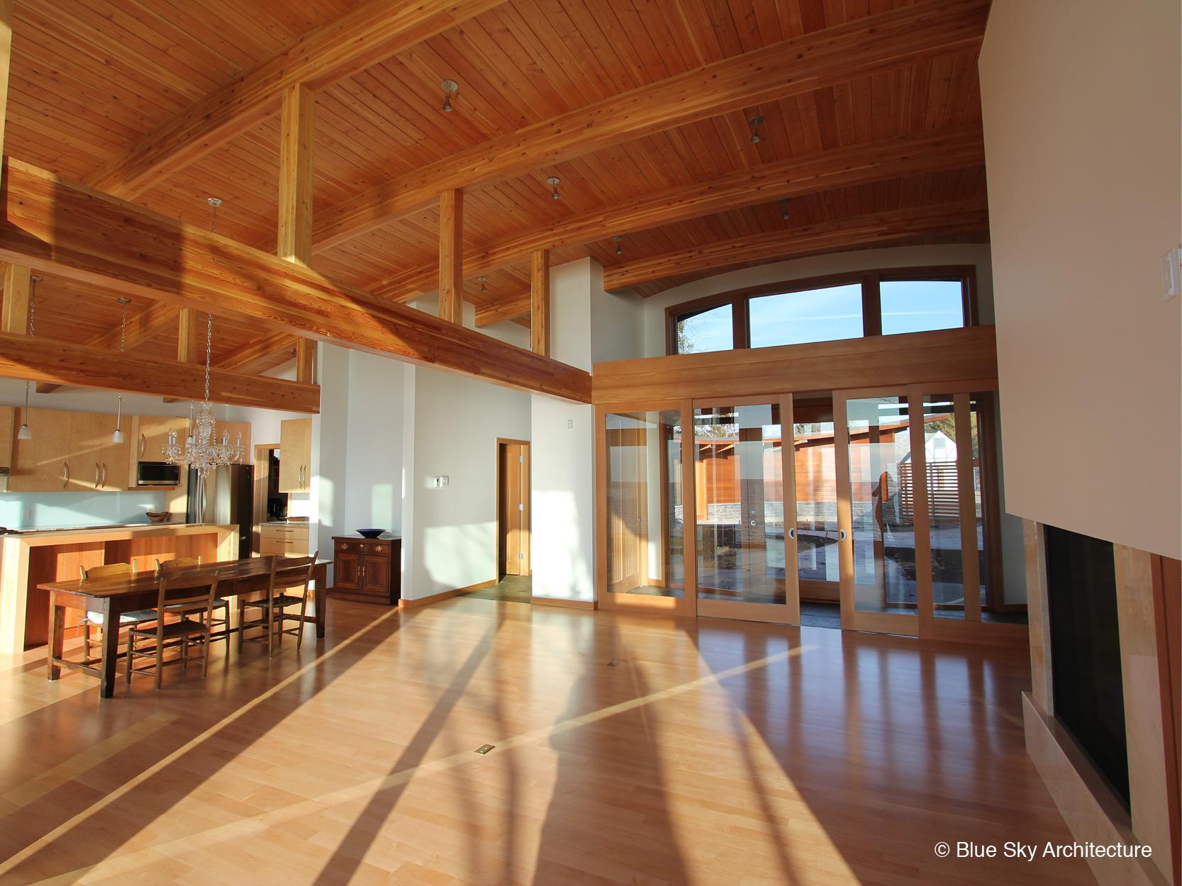 Open-floor-plan wood kitchen in lakefront home