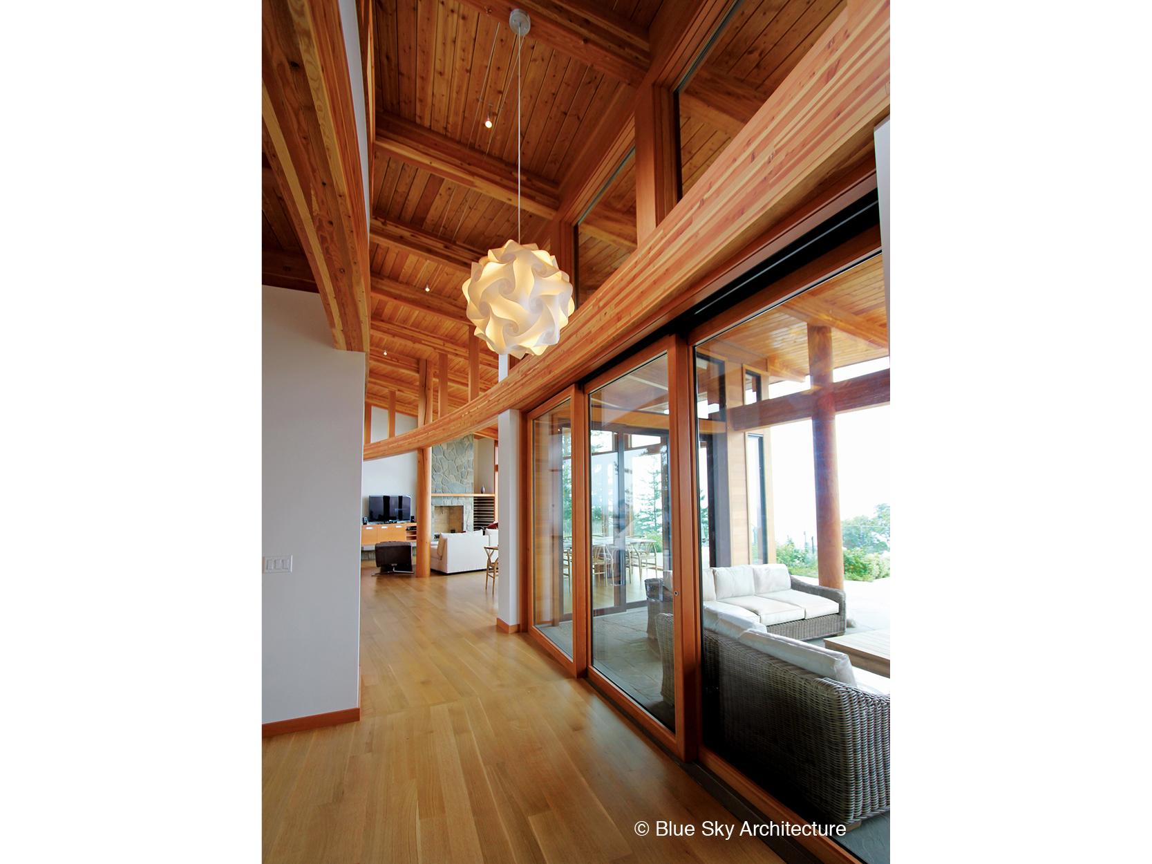 Indoor outdoor living room with sliding doors