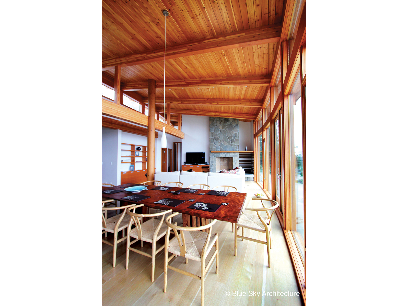 Open floor plan dining room and living room with post and beam construction