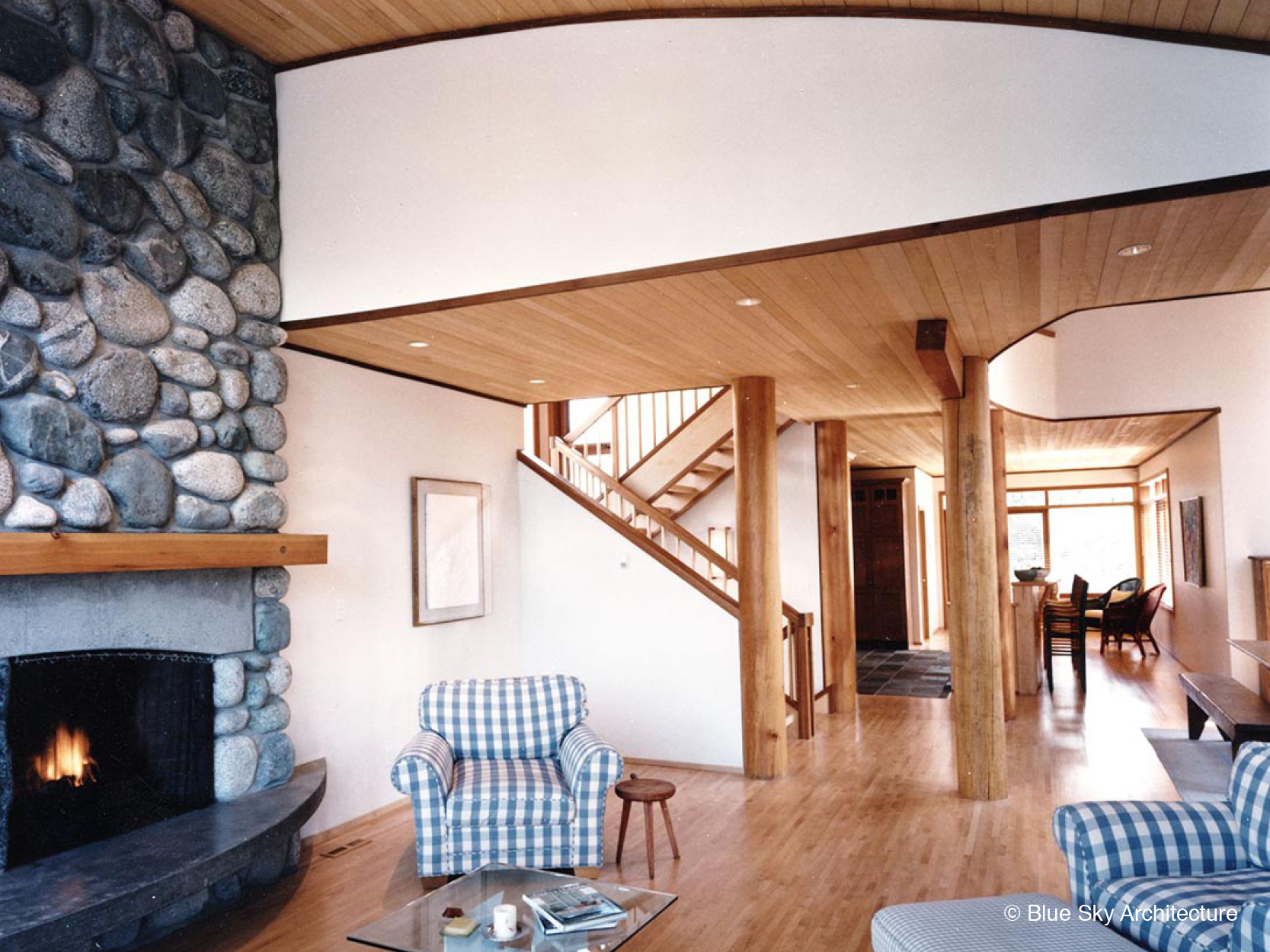 Open Plan Living Room with Stone Fireplace and Natural Materials