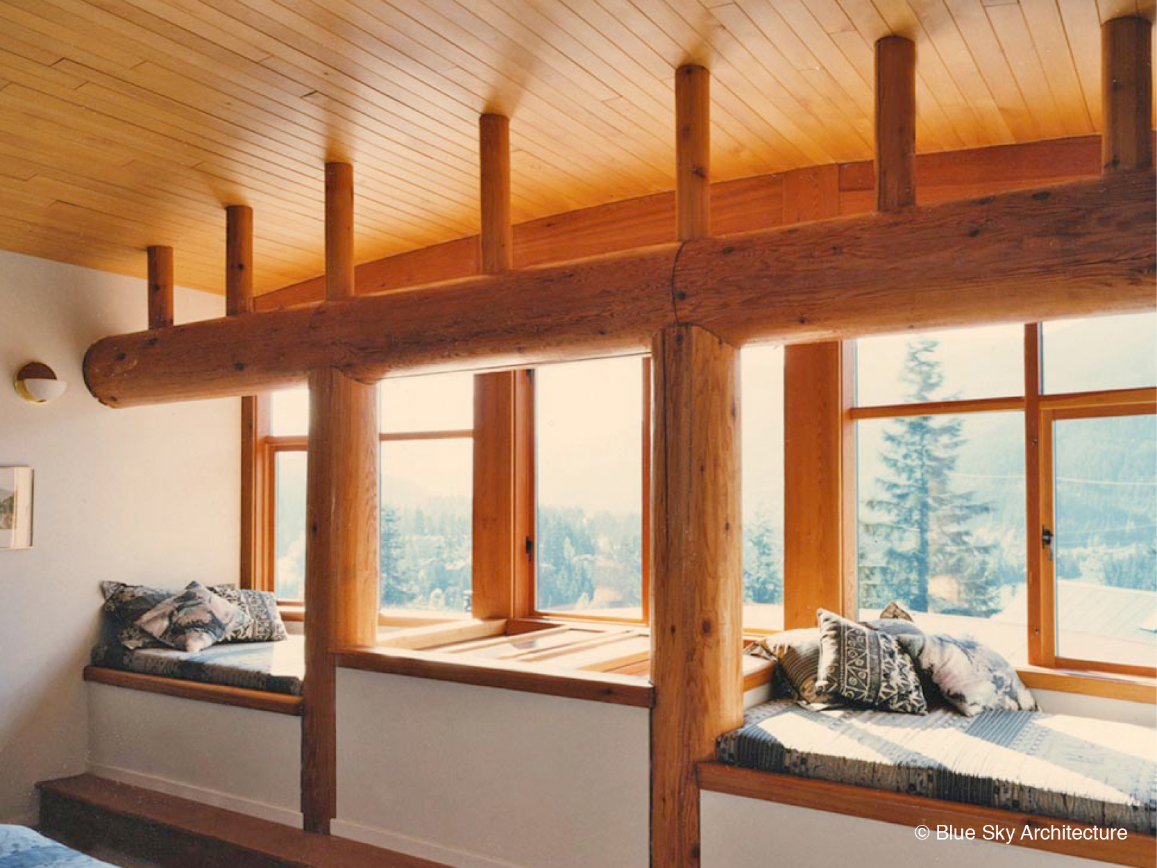 Sitting Room with Natural Log Rafters and Columns