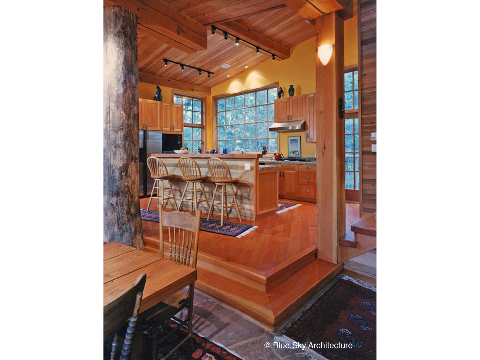 Kitchen Design with Wood Cabinetry and Floors