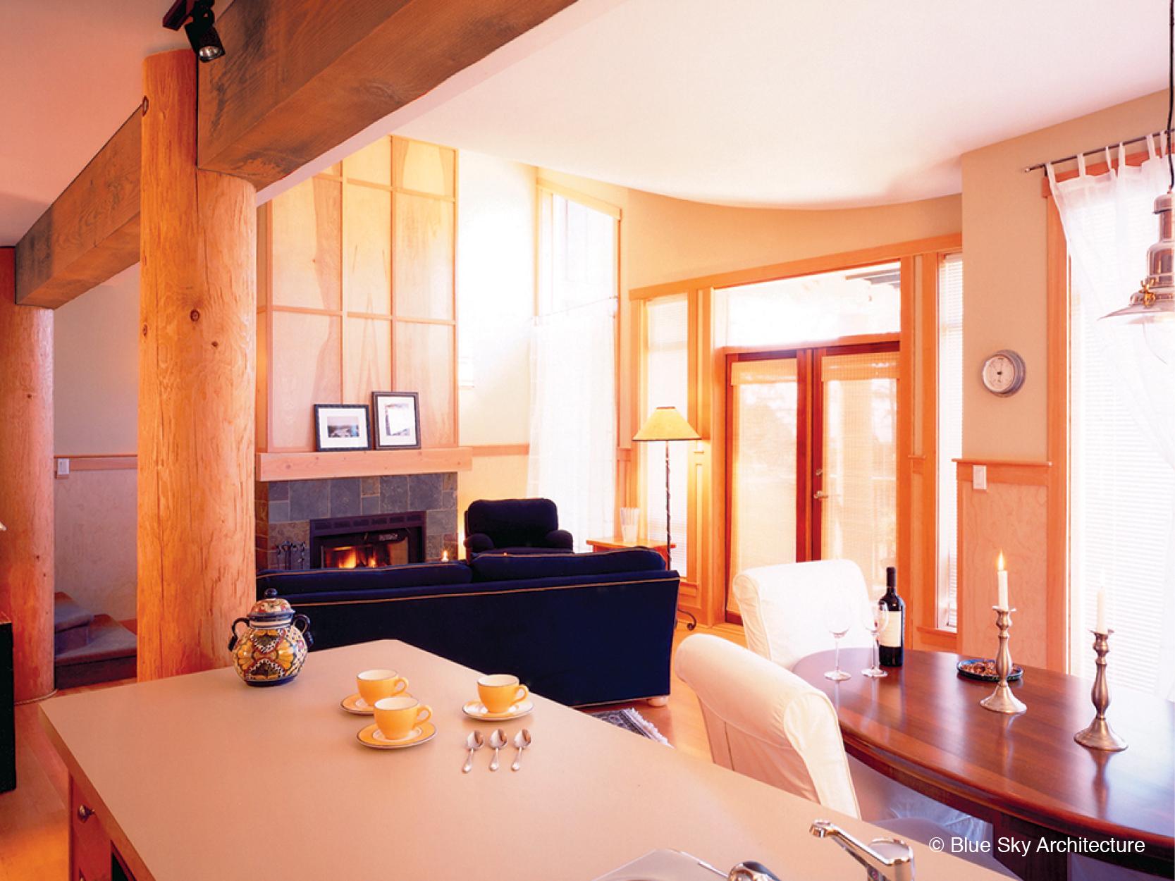 Open floor plan with heavy timber design