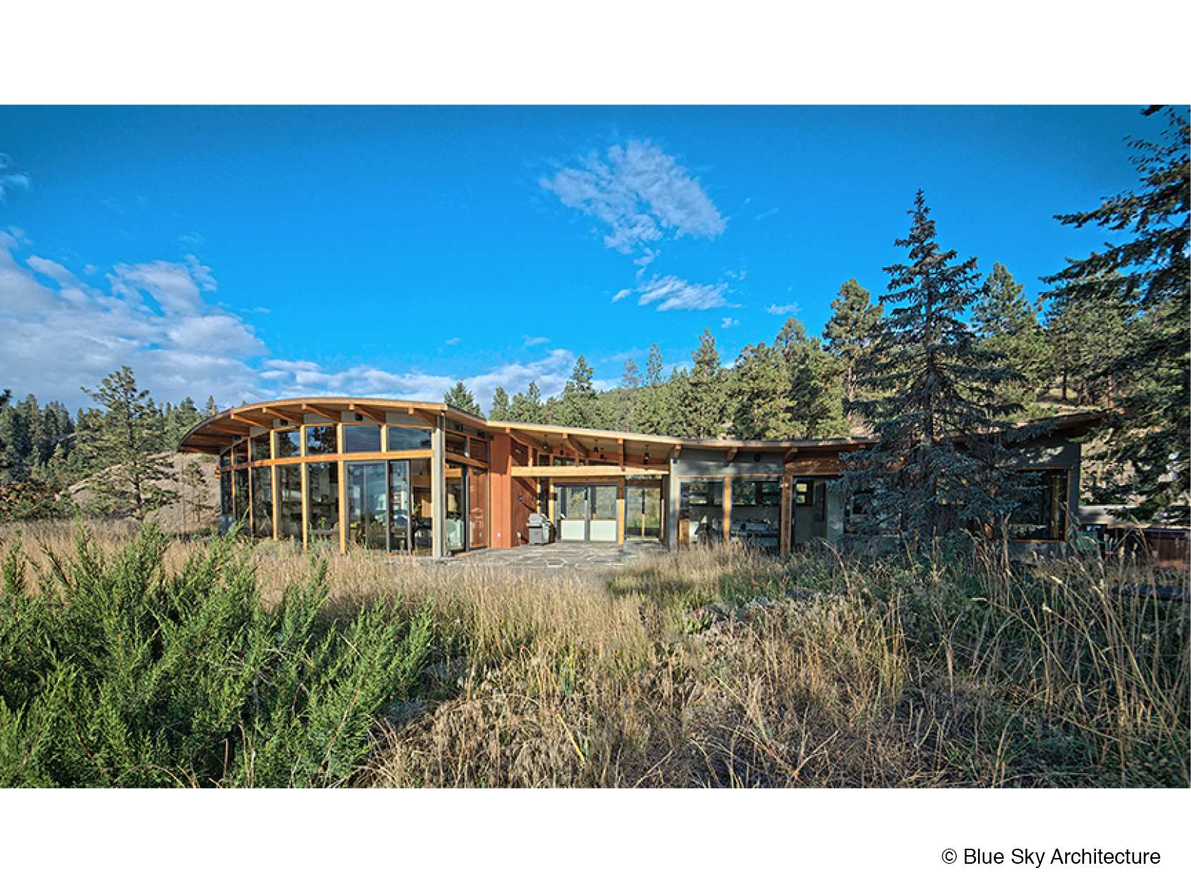 Full exterior view of the lakefront home design for Naramata Bench House