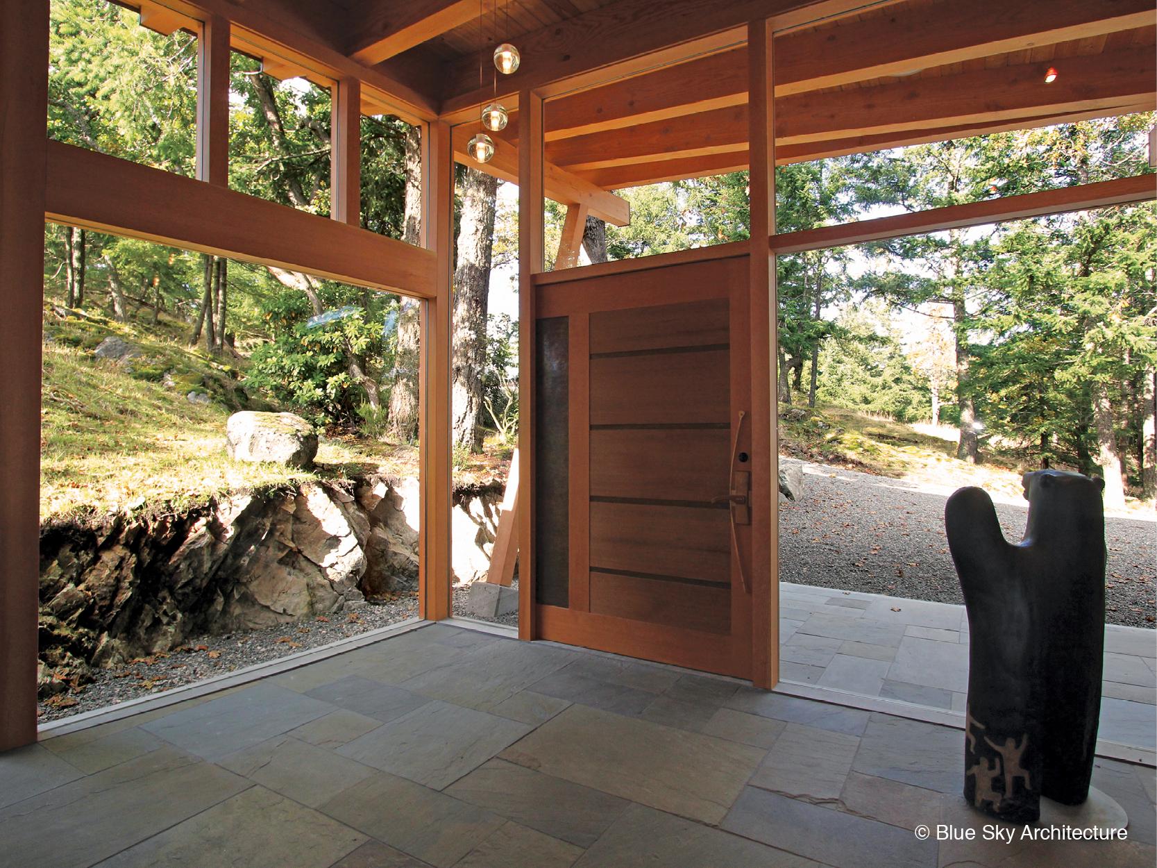 Oak Grove House entrance gallery with custom wood door