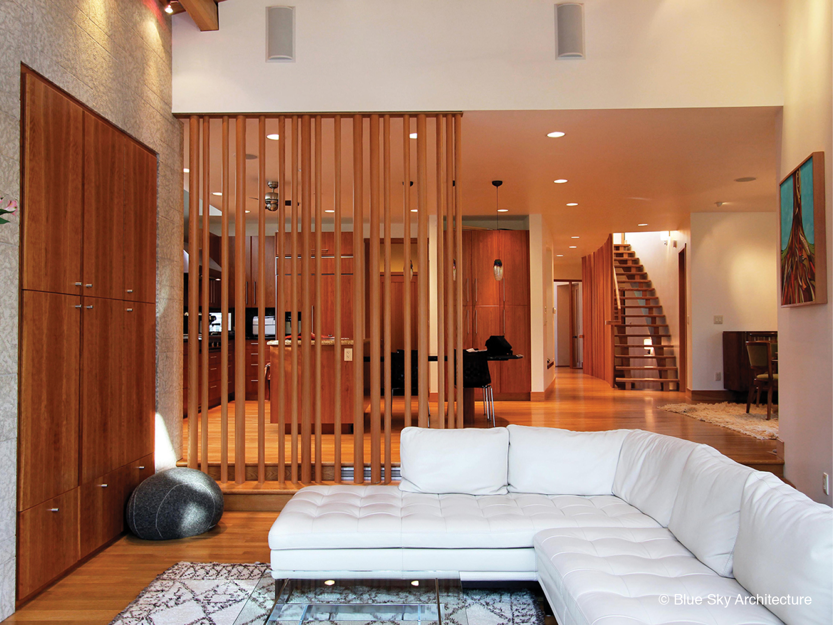 Wood screen separating living room and kitchen
