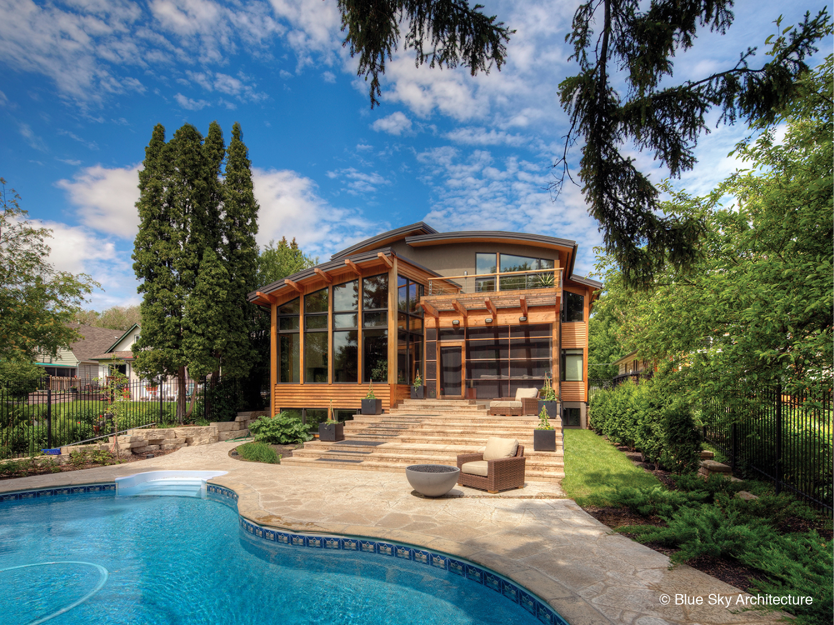 Assiniboine River house's organic architecture exterior, with terrace and pool