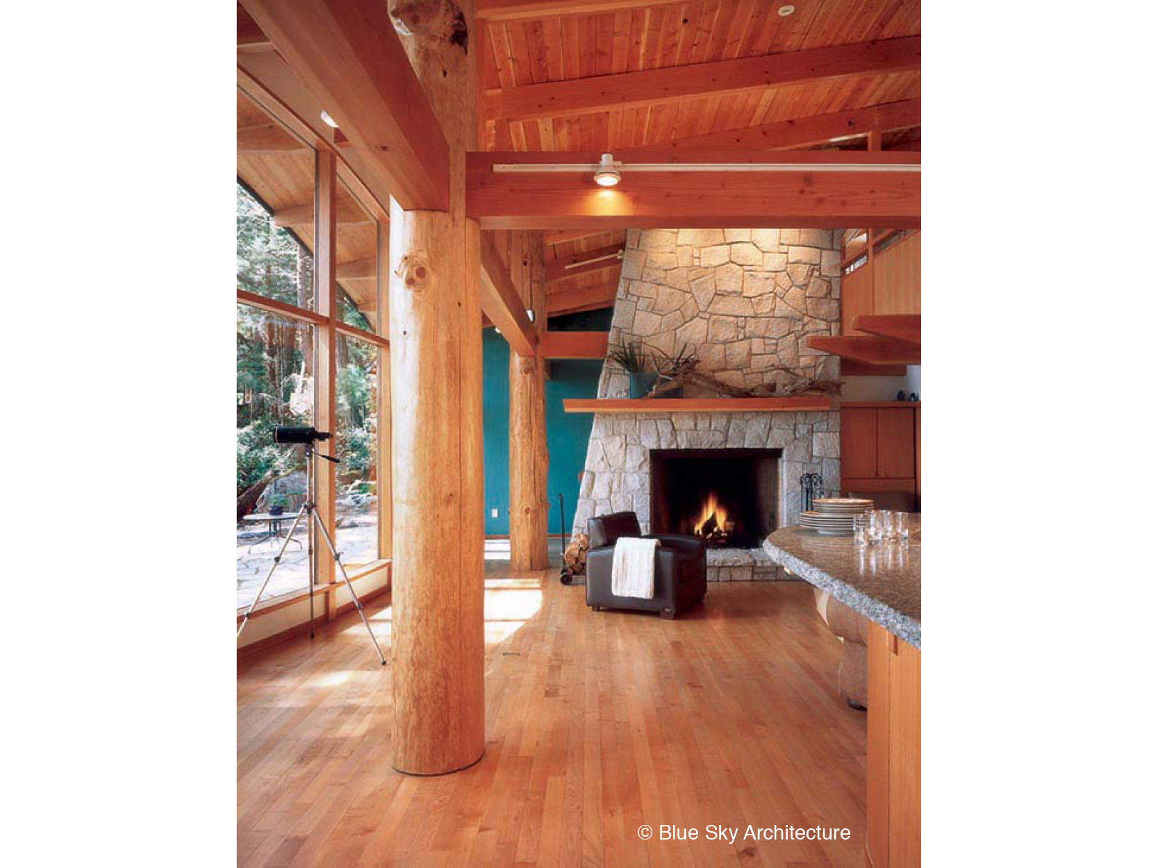 Heavy timber living room with stone fireplace