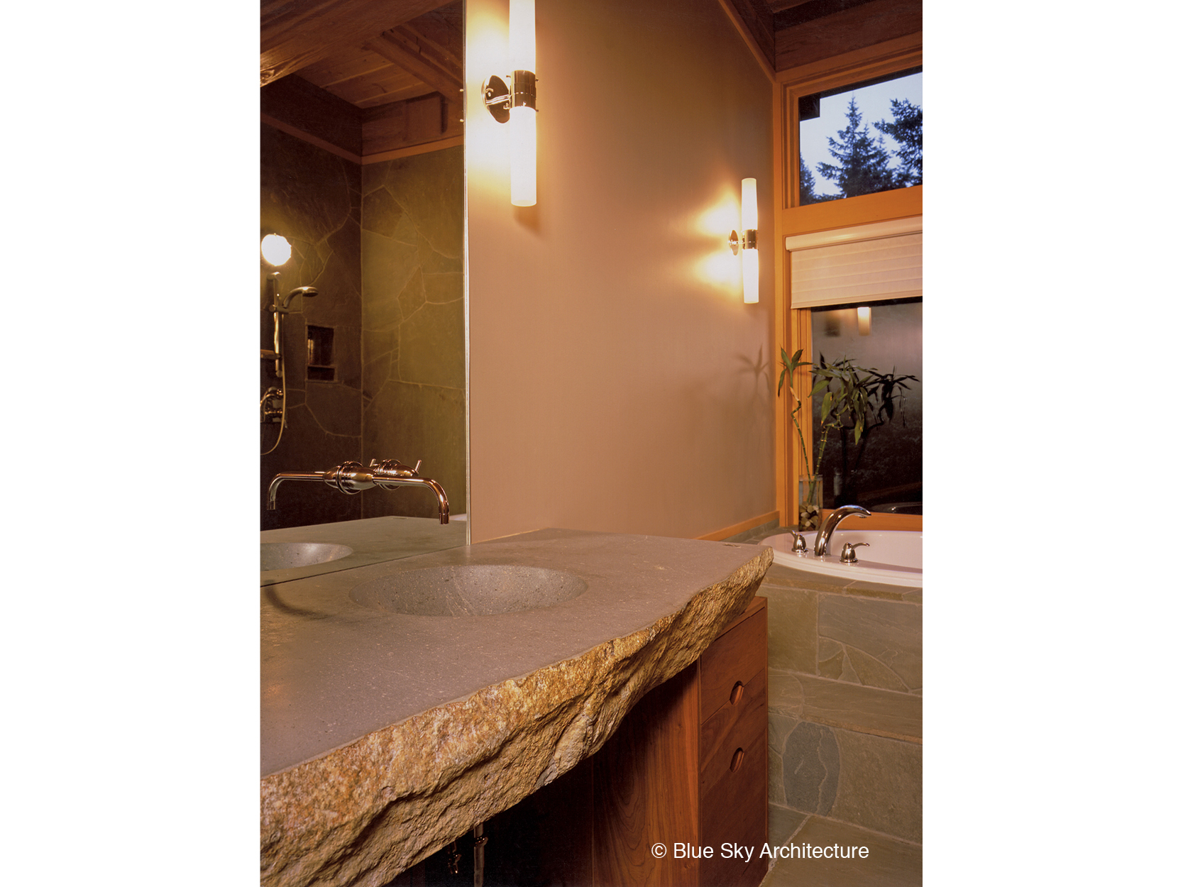 Basalt slab counter top in guest bath