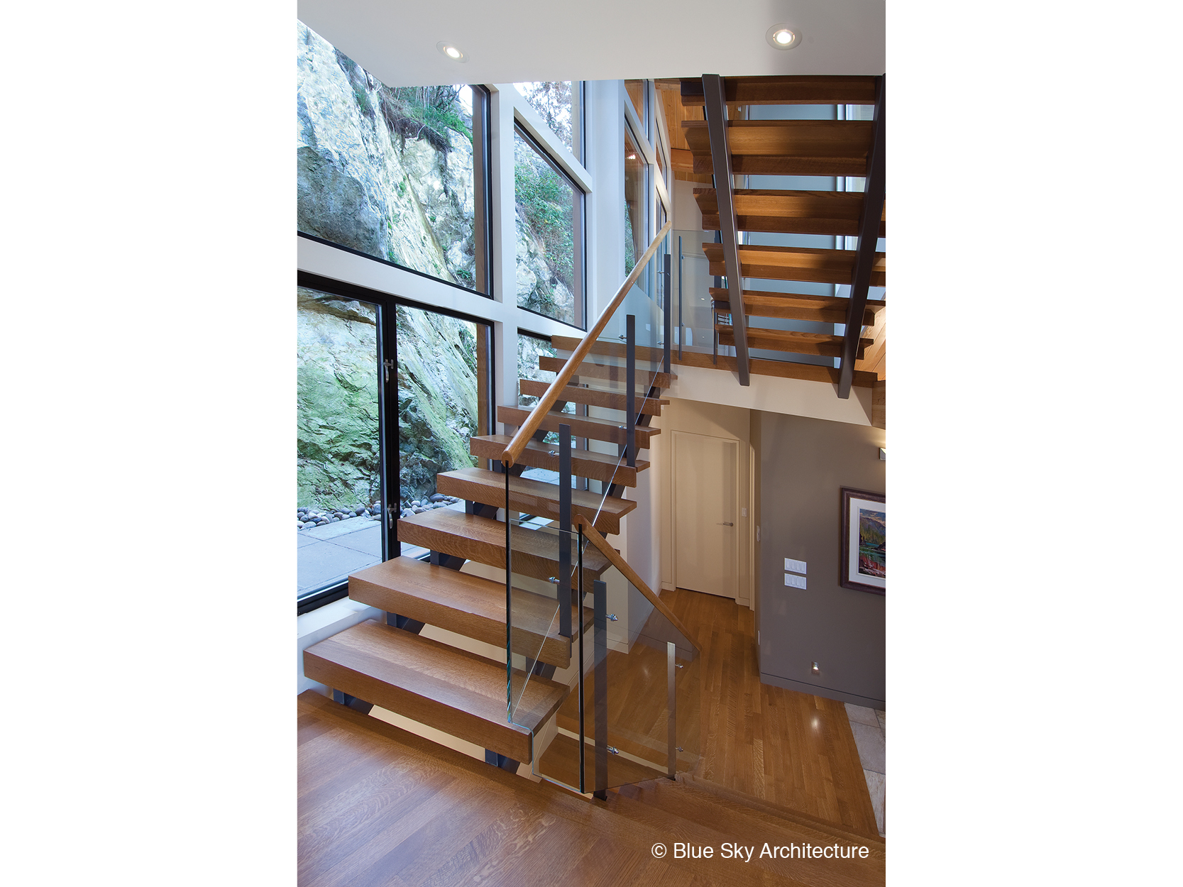 Natural lighting over the wood staircase of Harbour House