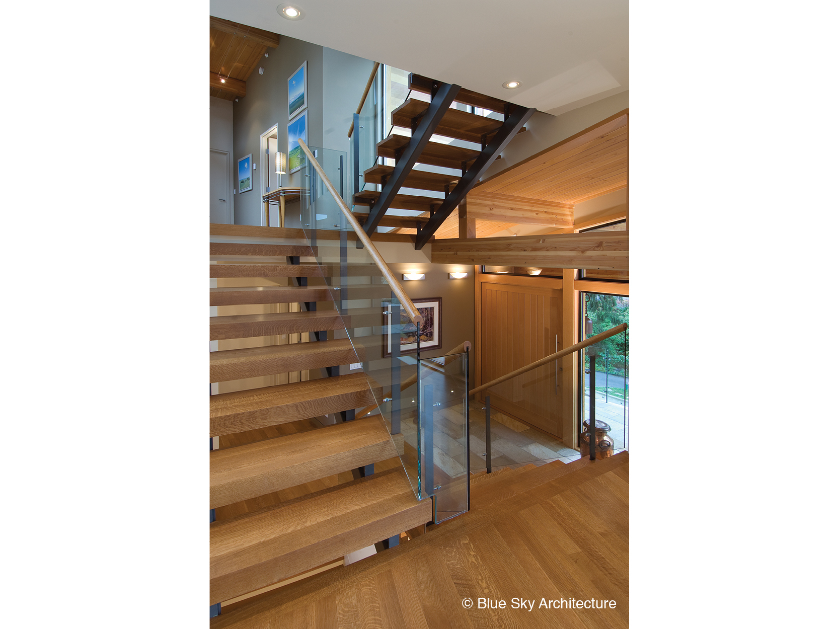 Wood and glass staircase of Harbour House