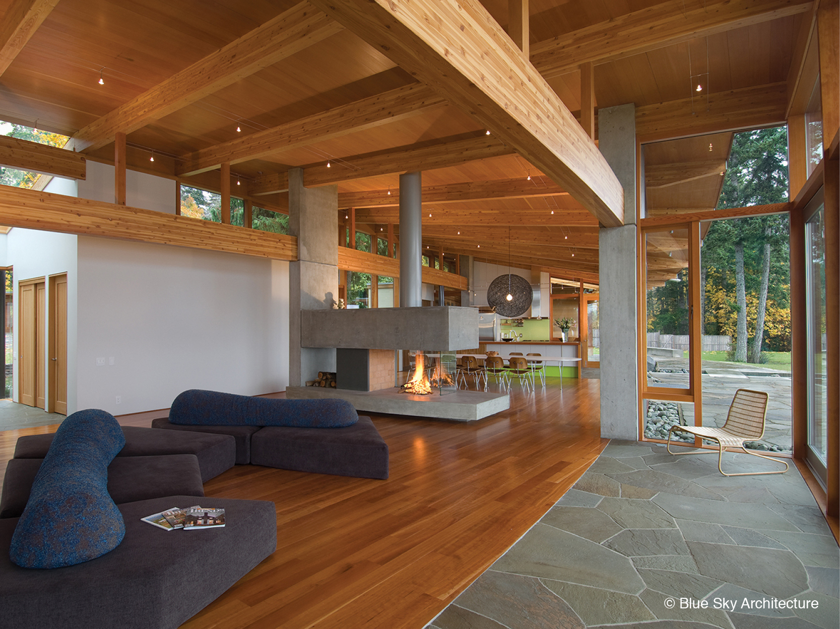 Wood rafter ceilings and open floor plan of Miracle Beach House