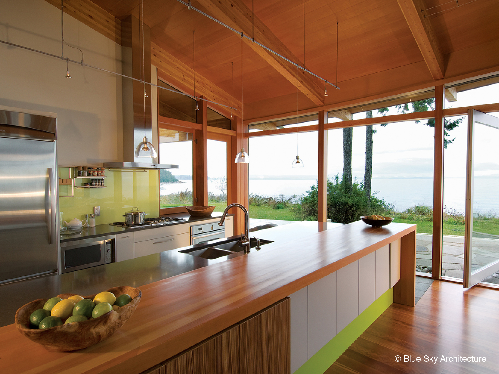 Natural lighting over the wood kitchen of Miracle Beach House