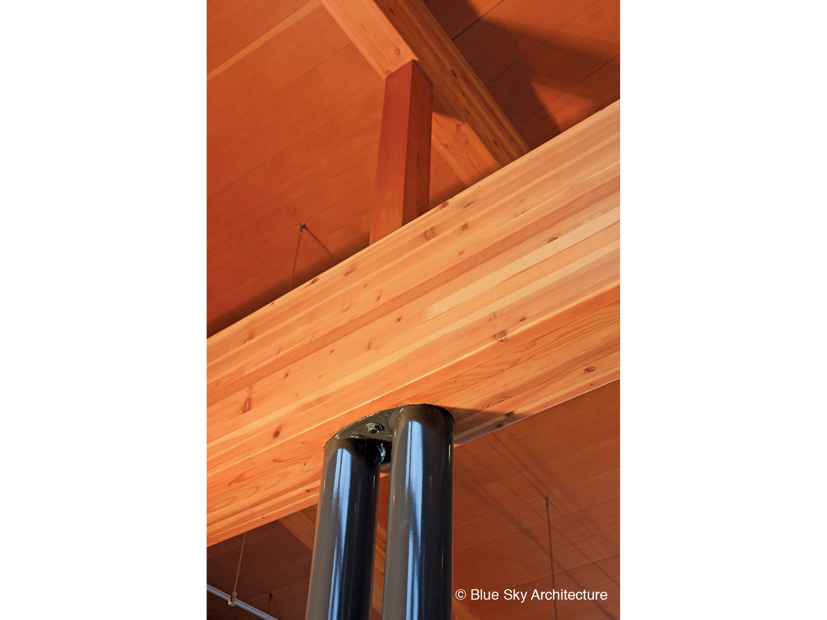 Steel column support of wood rafter in Miracle Beach House