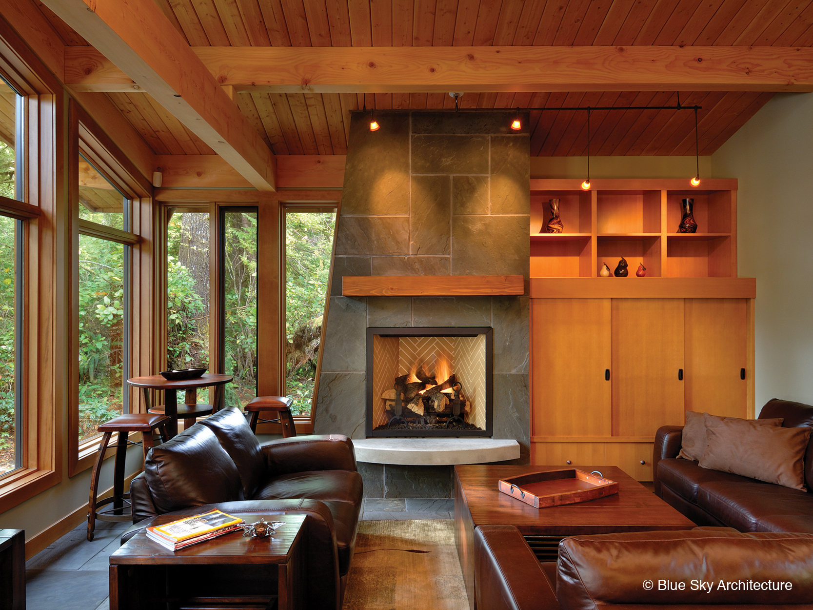 Stone fireplace in the all wood living room of Rainforest House