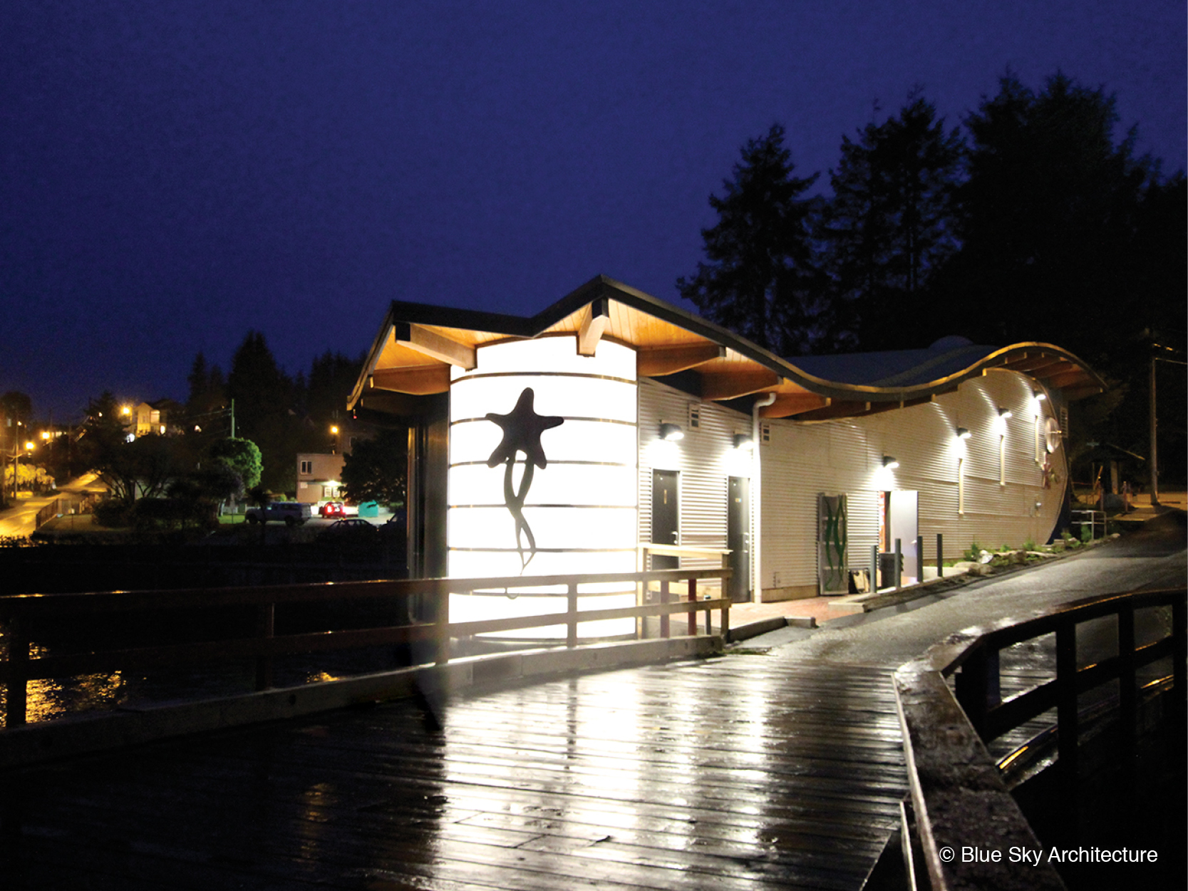 Exterior lights under the curved roof of the Ucluelet Aquarium