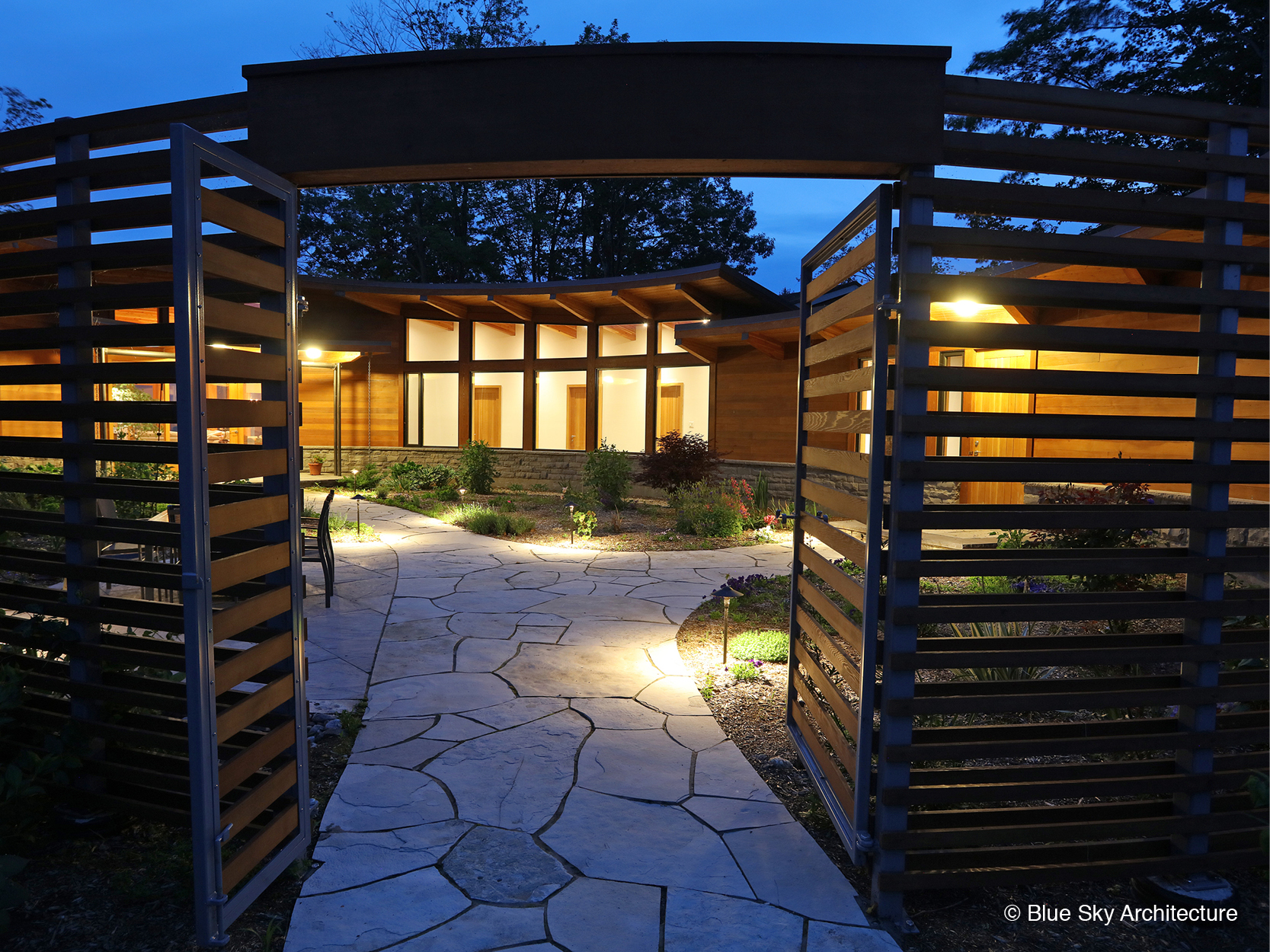 entrance canopy through landscaped courtyard