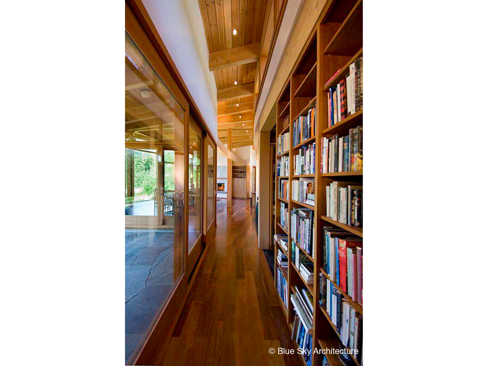 HollyFarm-house-hallway-bookshelves-wood-window.jpg