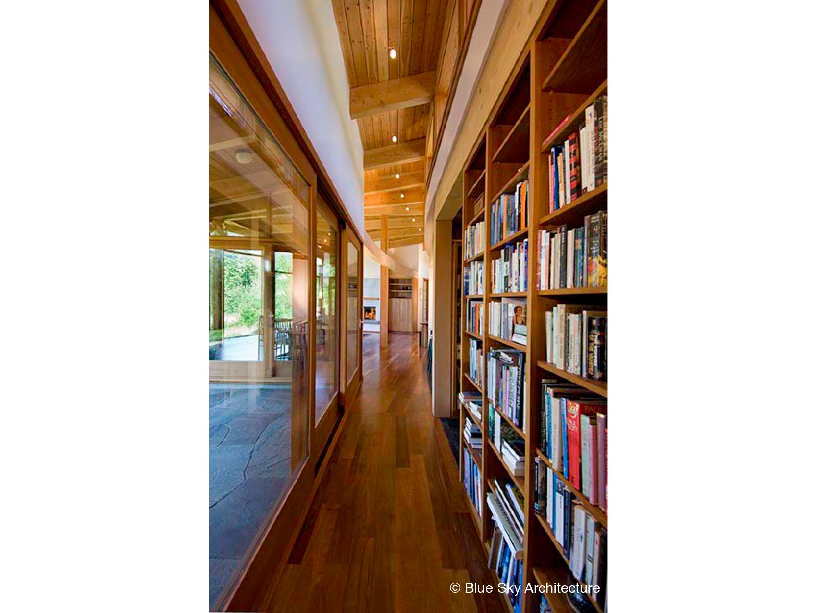 HollyFarm-house-hallway-bookshelves-wood-window.jpg