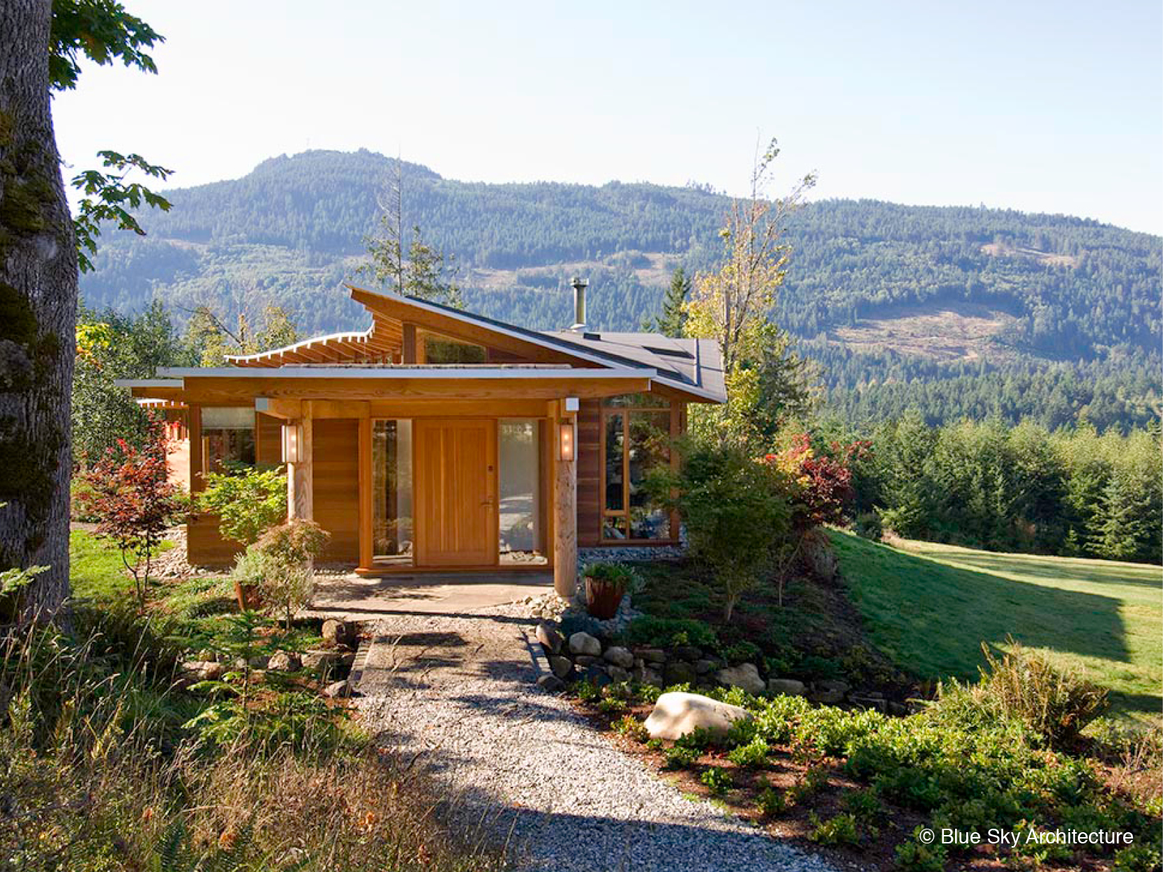 raw wood columns entrance house with landscape