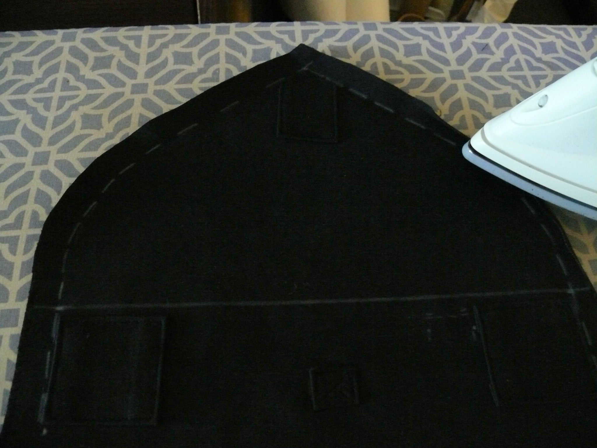 """Preparing to hem the foldover extention using a 5/8"""" ( 1.5 cm ) seam allowance folded double."""